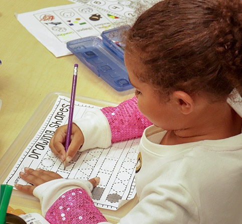 Young female student drawing shapes